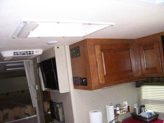 2013 Lance 1172 Cab Over Dual Slide Out 12 Ft.